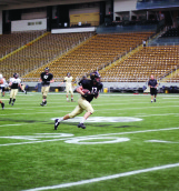 """Junior tight end Tren """"Buck"""" Cowan with the ball during practice Wednesday. The Vandals will be playing Louisiana-Monroe for the University of Idaho Homecoming Game Saturdayat 2 p.m. in the Kibbie Dome."""