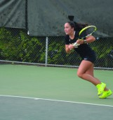 Lucia Badillos, sophmore at UI practicing tennis on Wednesday September 30th on the Tennis courts behind the Memorial Gym