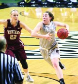 Sophomore post Geraldine McCorkell drives toward the basket during the first half of the game against Montana Thursday at Cowan Spectrum.