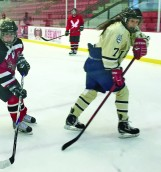 Idaho player Keanna Hawk and Eastern team captain Brooke Bogart follow the puck on Saturday in Cheney.