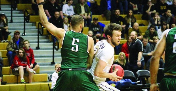 Sophomore forward Arkadiy Mrkrtychyan drives into the key against Portland State Saturday at the Cowan Spectrum.
